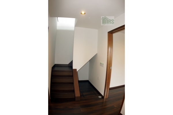Entrance and stairs to 2nd Floor.