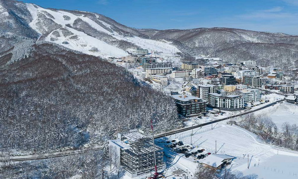 Niseko Hirafu Ski Resort Village with INTUITION Niseko in foreground. Contact NRS 0136-23-2221.