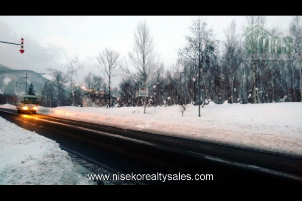 68m of road side frontage. Looking northwest with Niseko Grande Hirafu Ski Resort in the background.