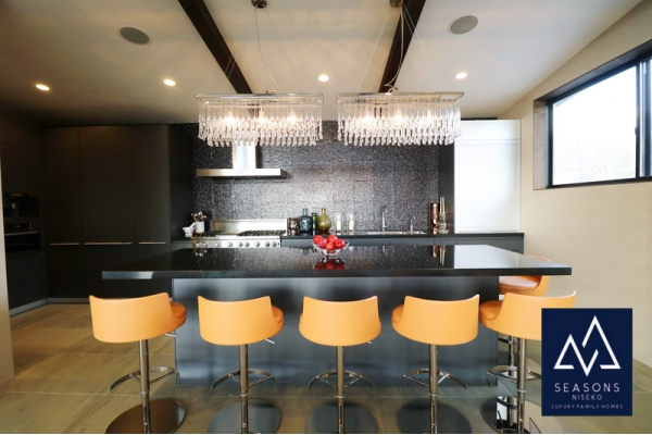 Gourmet Kitchen focused on entertaining, built-in espresso maker and deluxe applicances.